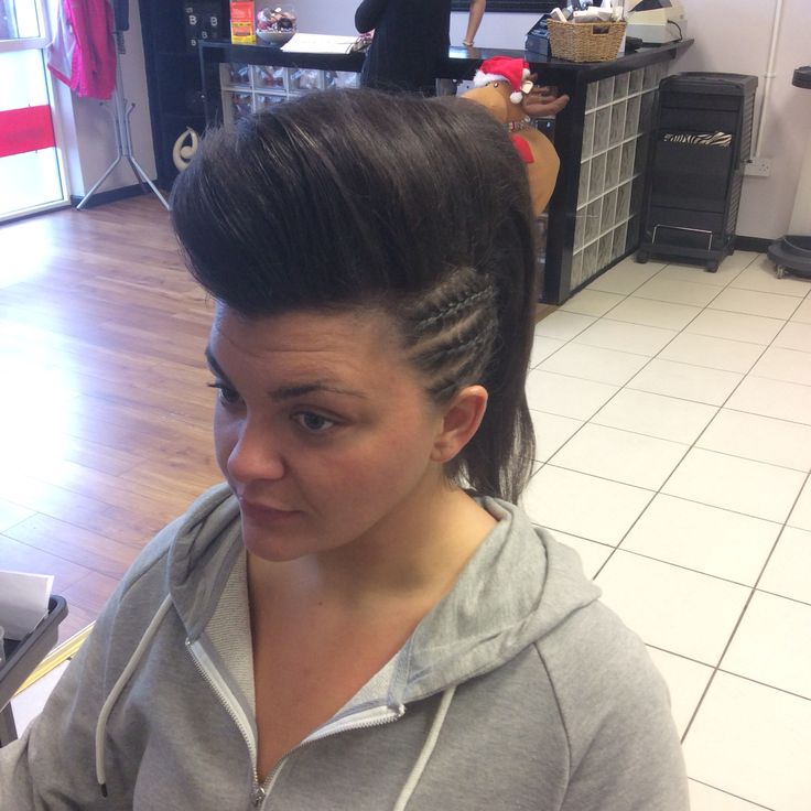 A mohawk inspired up-style with side plaits and side sweeping bump