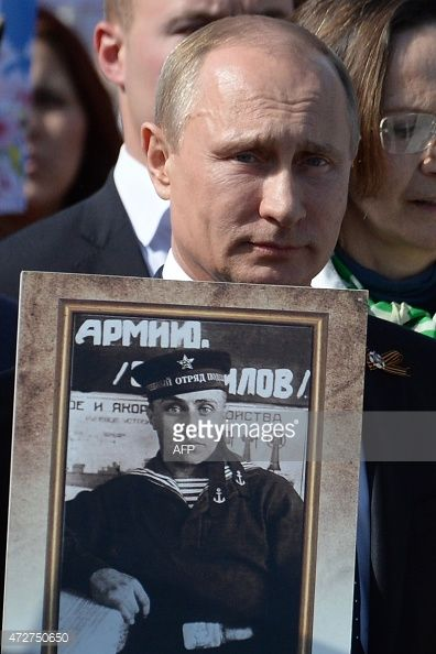 472750650-russian-president-vladimir-putin-carries-a-gettyimages.jpg (396×594)