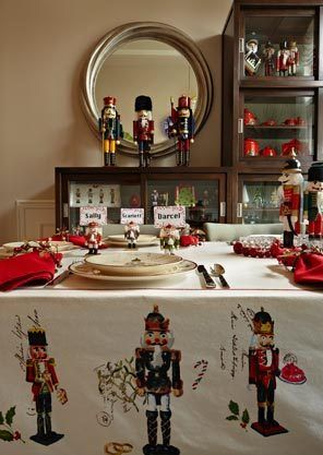 """""""Table setting is my very favorite thing,"""" Paxton says. """"I'm passionate about dishes. The Christmas dishes are just the tip of the iceberg."""" She has about 25 sets of dishes. She also has sets of snowmen, Santas, gingerbread, peppermint candy, Swedish, nutcrackers, used here, and the Spode Christmas trees."""