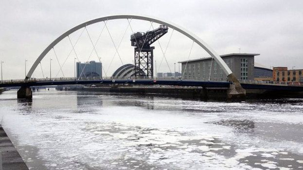River clyde with foam under squinty bridge and stobcross crane April 4 2014