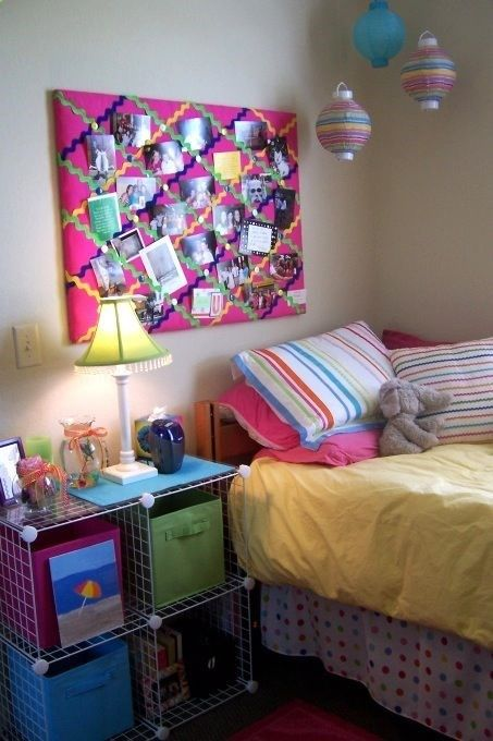 HGTV college dorm...loving the bulletin board, and you can make it your self. Cover a bulletin board in fabric then criss cross ribbon.
