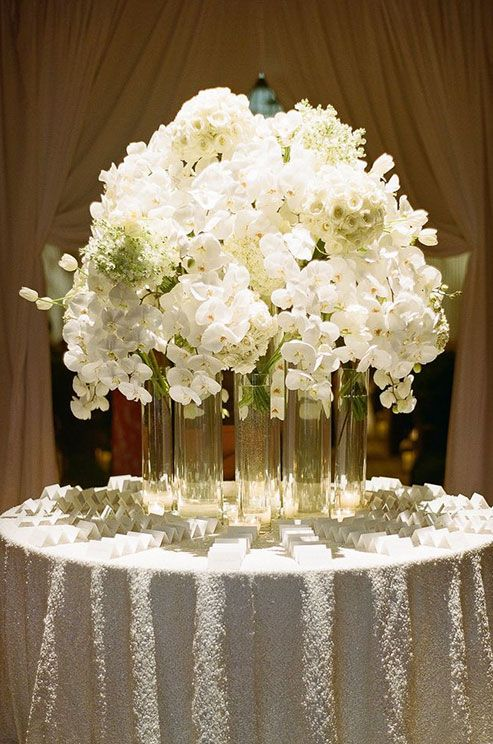 This elegant centerpiece containing orchids hydrangeas