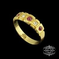 Antique Australian Ruby Ring Created circa 1890 this 18ct yellow gold Victorian 'Gypsy' ring is inset with three rubies and two diamonds.