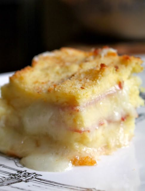 Soft, souffle-like mashed potatoes layered with ham and melted mozzarella and topped with breadcrumbs! Be still my heart!