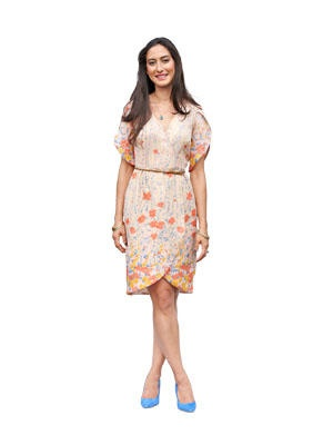 Nicola features feminine floral detailing throughout with a tulip skirt and petal sleeves. The wrap dress secures with buttons, which allows for pairing with your favorite belt.