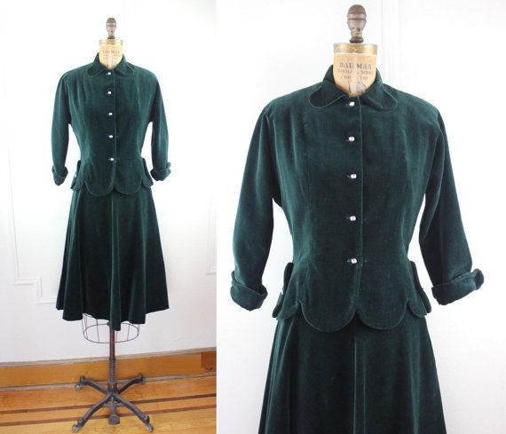 amazing outfit from the 1940s. rich and dark emerald green velvet. the top has a delightful peter-pan collar. there are 5 rectangular, prong set crystal buttons up the front, and 1 on each side of the cinched waist. dolman sleeves, with turned backed cuffs. fitted princess seams up and down the front and back. scalloped bottom hem. satin shoulder pads are stitched in, though can easily be removed if so desired. unlined.  the skirt has a great aline shape, with a metal zipper up the side and…