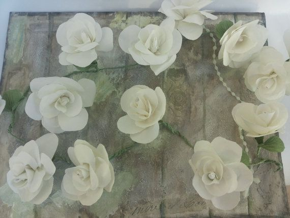 Flower garland   https://www.etsy.com/listing/191595741/tissue-paper-flower-garland-table-flower