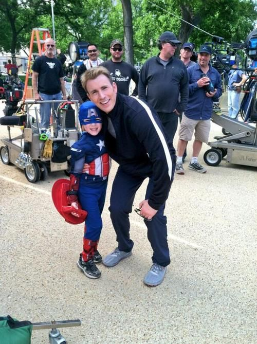 Chris Evans on the set of Captain America: The Winter Soldier with a little admirer. Precious <3