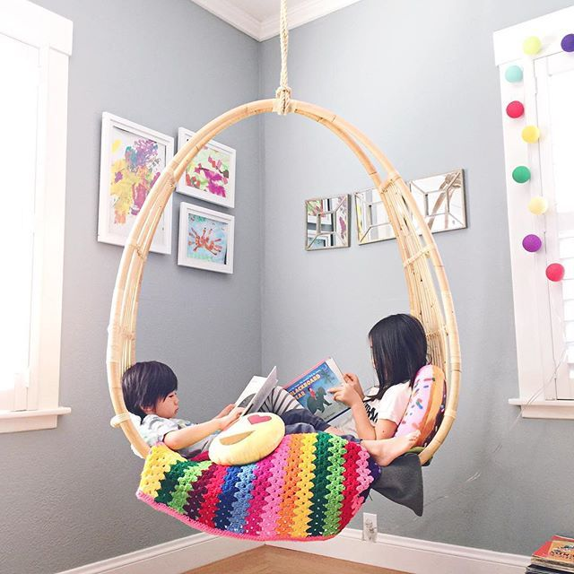 Awesome hanging chair for kids. This would look awesome in the kids bedroom  or playroom