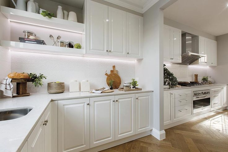 Galley kitchen and butlers pantry in the Brookwater display with a Classic Hamptons World of Style.