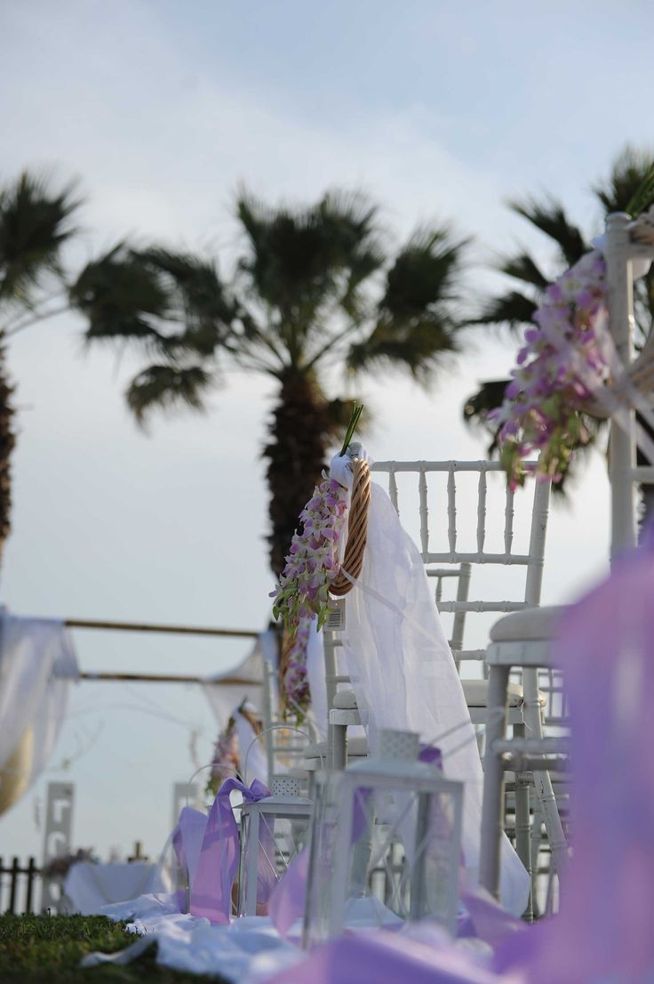 #chairs #guests #wedding #light #wreaths #flowers