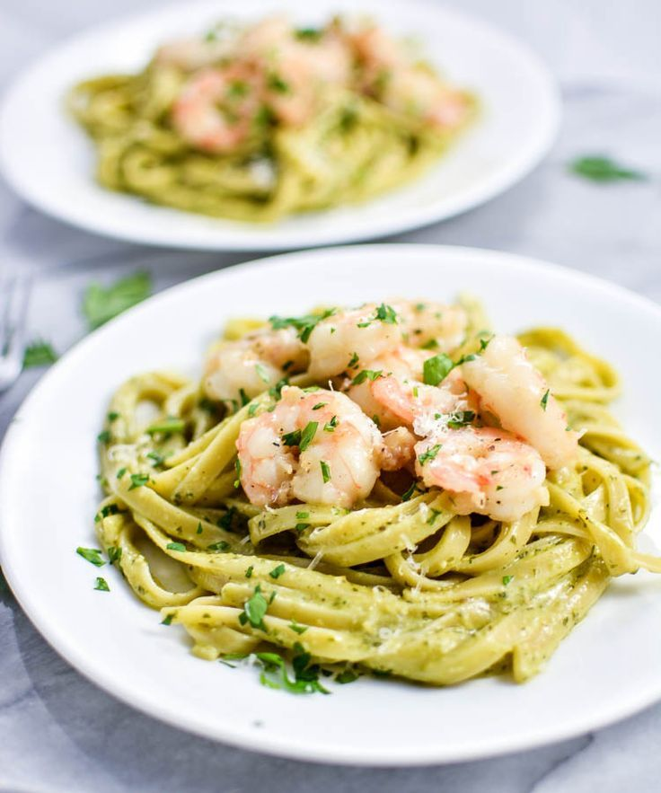 Creamy Pesto Pasta with Garlic Butter Shrimp | You wouldn't believe it only takes 3 simple steps and 45 minutes to make this dish -- but it does! Try it for dinner tonight.