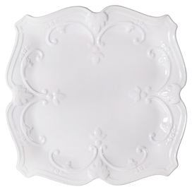 "Craft a lovely tablescape for your next family meal or alfresco dinner party with this lovely ceramic dinner plate, showcasing embossed scrolling details and a white glaze finish.    Product: Dinner plateConstruction Material: CeramicColor: WhiteDimensions: 10.5"" W x 10.5"" D"