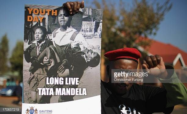 A man participates in a march to commemorate Youth Day in Soweto Township on June 16 2013 in Johannesburg South Africa Youth Day commemorates the...
