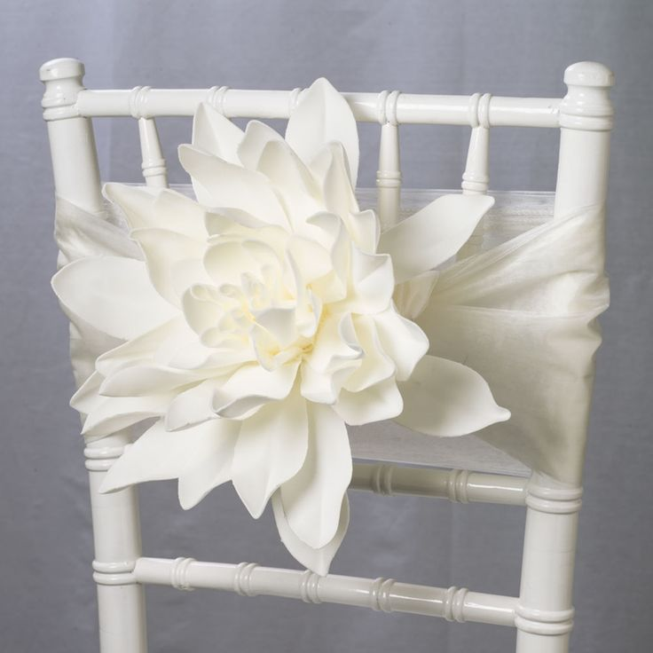 Accent your wedding chairs with an oversized faux flower! These white artificial dahlias are a statement piece in garden, rustic chic, modern and spring receptions.