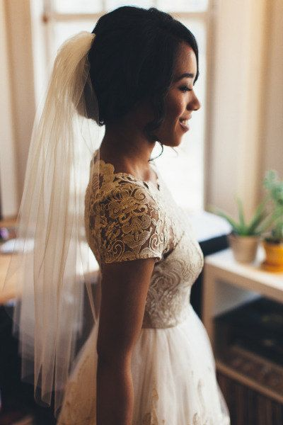 Simple and feminine wedding dress, veil and updo