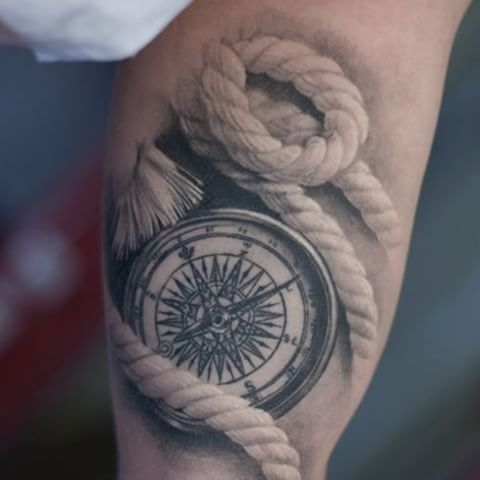 Nice Compass And Rope Tattoo On Bicep