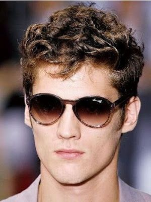 short, curly mens hairstyle