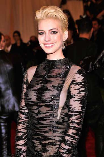 Anne Hathaway debuted a peroxide-blond hair color that shocked us all. The actress said that Debbie Harry inspired her punk transformation for the night. #MetGala