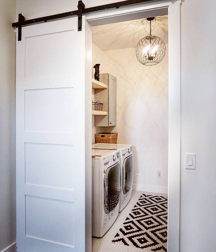 "Fun fact... my laundry room is right off my master closet. Another fun fact... I can stand in my kitchen and throw dishtowels into my laundry room... both were ""must haves"" for me.  I know I have some weird priorities but let's get real... I'm kind of lazy when it comes to housework! . Thought this pendant from @worldmarket and this rug from @rugs_usa were the perfect combo to add some style to this room! . . .#abmathome #abmhappylife #wowusweekdays #laundryroom #laundryroominspo #barndoor…"