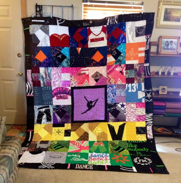 This is a Dance Costume Quilt that I created for a girl who is graduating in 2015. She danced for 16 years and these are her costumes put into a Memory Quilt that she can treasure forever. :)