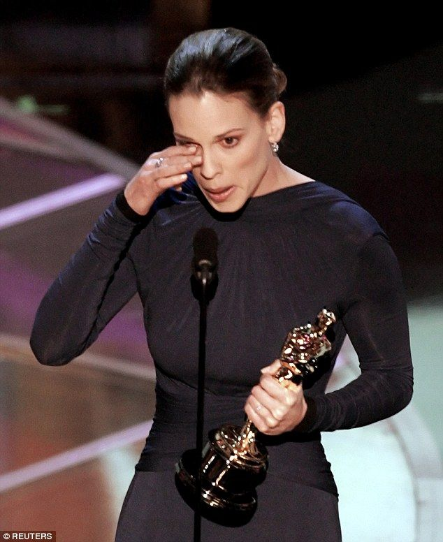 Hilary Swank wipes away a tear as she accepts the Oscar for best actress in 2007 for Million Dollar Baby