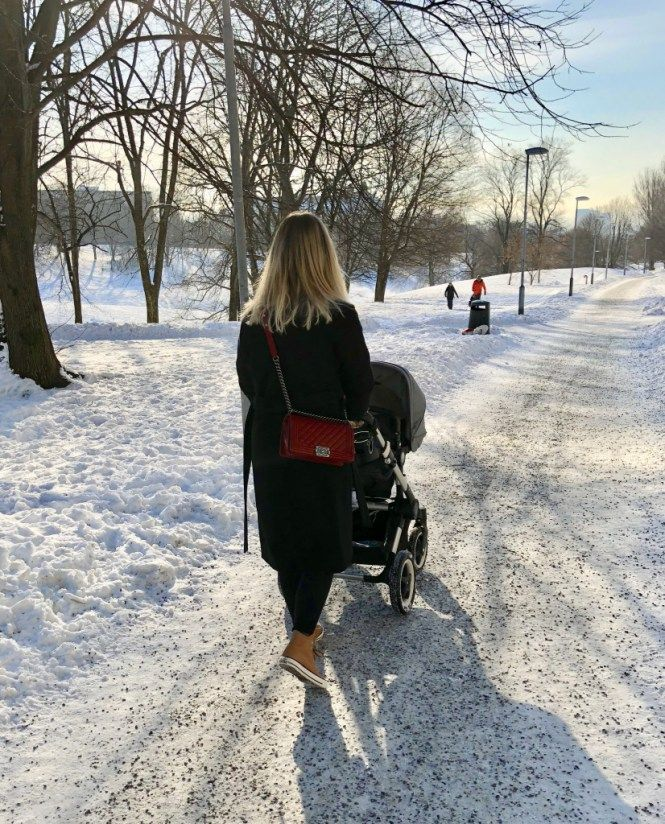 A walk in the park with my baby boy in a Bugaboo stroller. Wearing a black outfit with camel leather Converse, black Gucci belt and a red Chanel Boy bag.