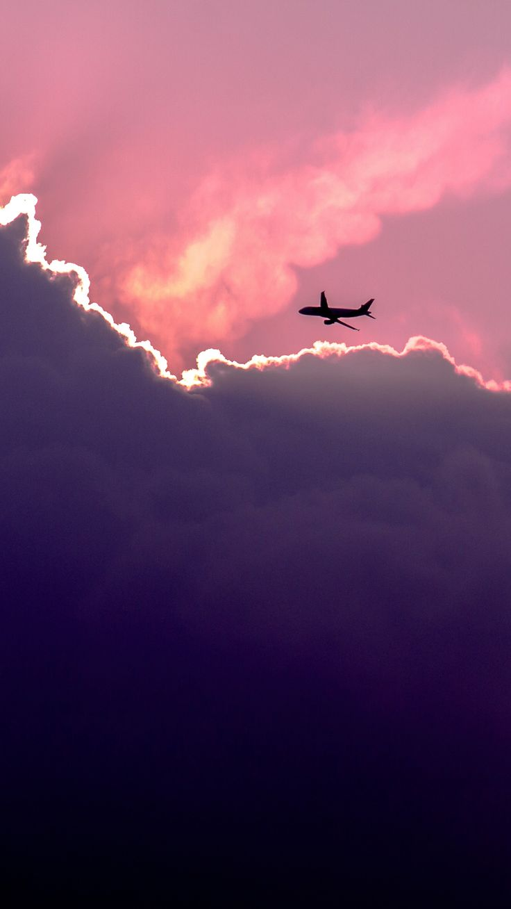 Plane Above Sunset Clouds iPhone 6 wallpaper