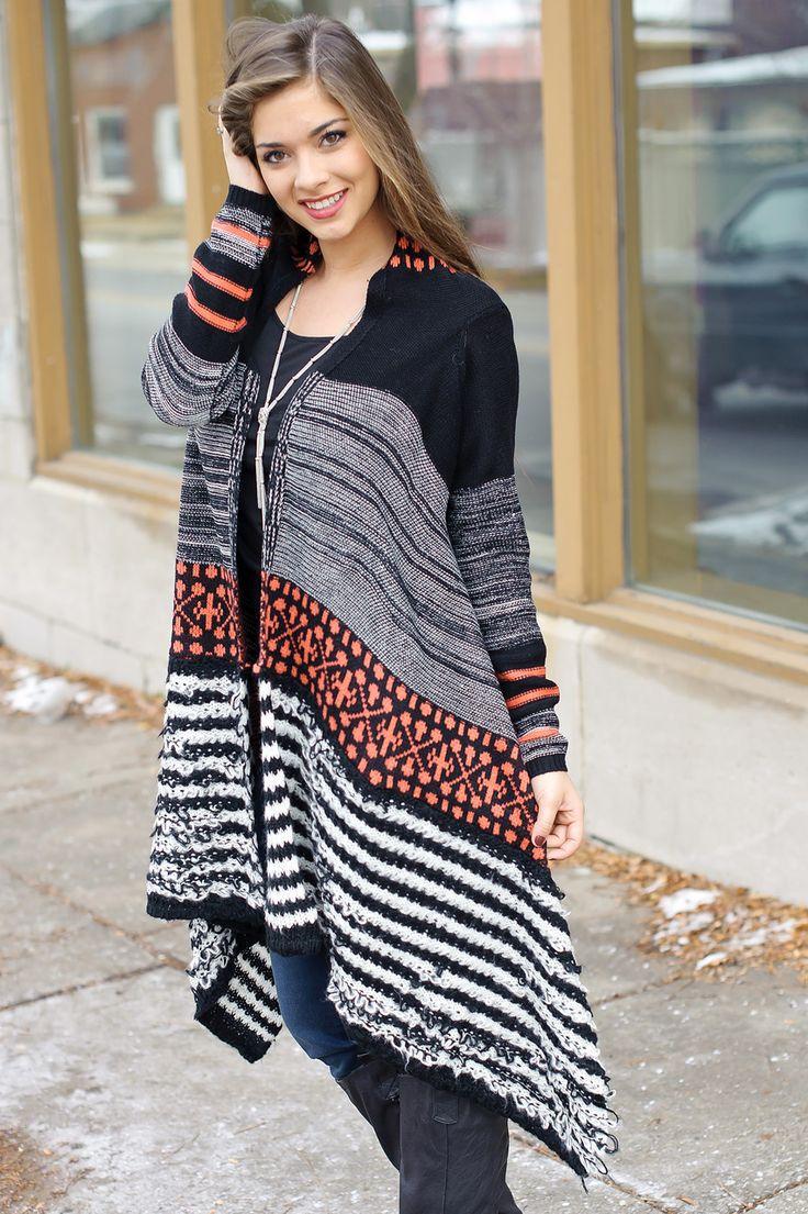 Jacquard knit open multi color cardigan with asymmetrical hem.