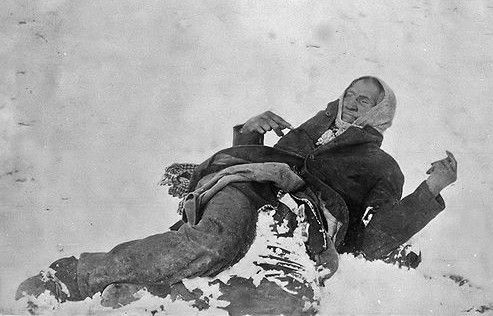 Chief Bigfoot lies dead in the snow where he fell after the massacre at Wounded Knee. A severe snow storm hit shortly after the firing stopped. Three days passed before anyone went back to remove and bury the dead. All the bodies were frozen. Chief Bigfoot still held his rifle in this pose. It was removed just prior to the photo.