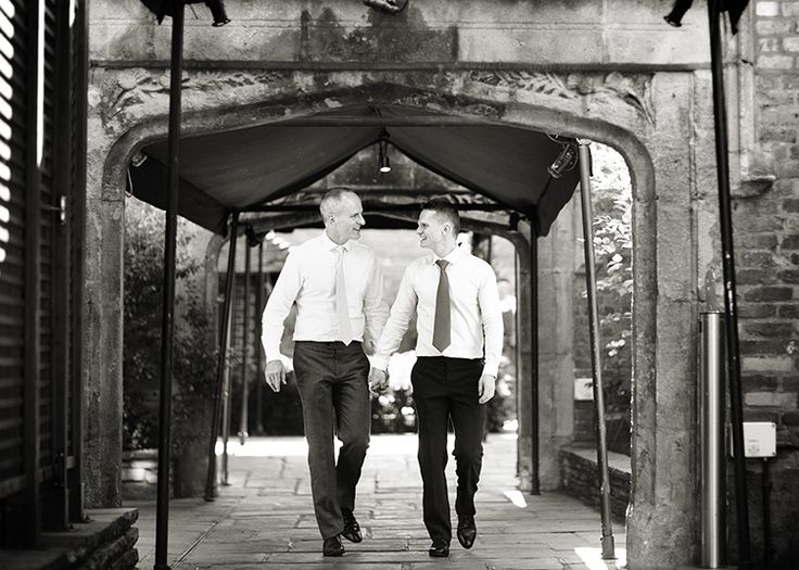 Mark and Jeremy on their wedding day at the Roof Gardens in Kensington, London