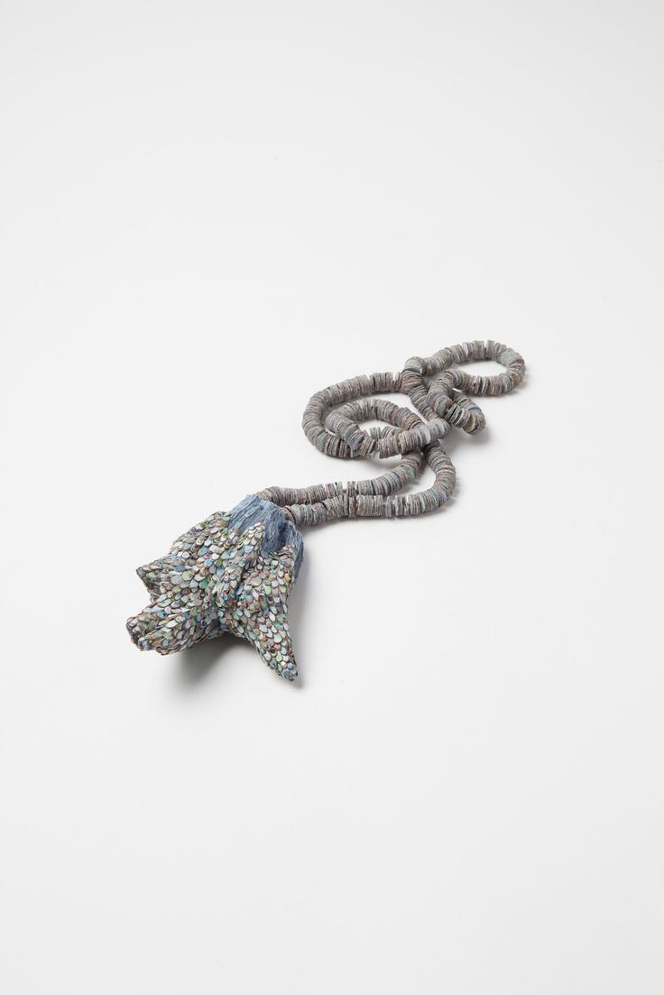 Carina Shoshtary -    Rabbit´s Foot Necklace. Graffiti, wood, silver, paint, string: