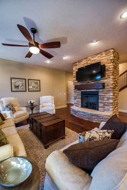 Great room; living room; stone fireplace; transitional; wood floor; Craftsman style