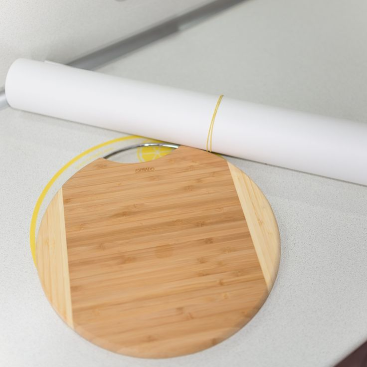 Cutting board and a roll of thick paper