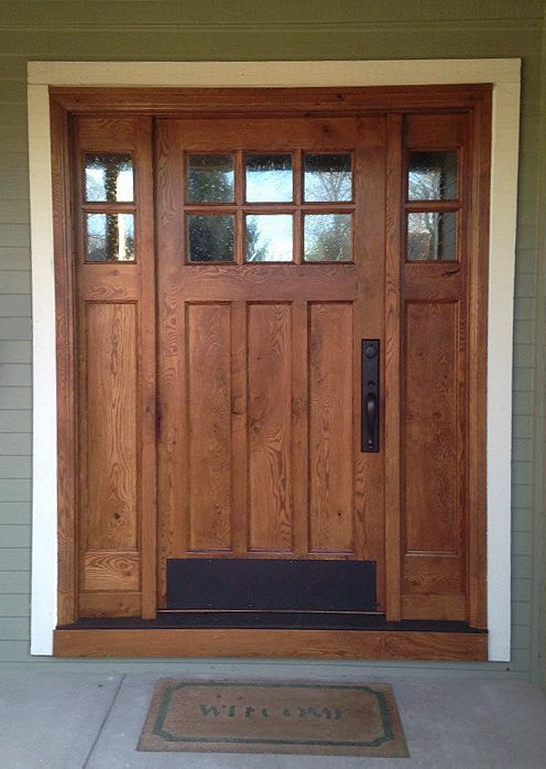 This Craftsman style door and sidelights, built of rustic white oak, features flat panels and upper divided lights.  Decorative seedy glass complements the style and allows natural light into the entryway.