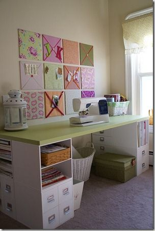 sewing/crafting table - looks like a door on 4 shelves....great storage idea for underneath too....Love the fabric back wall