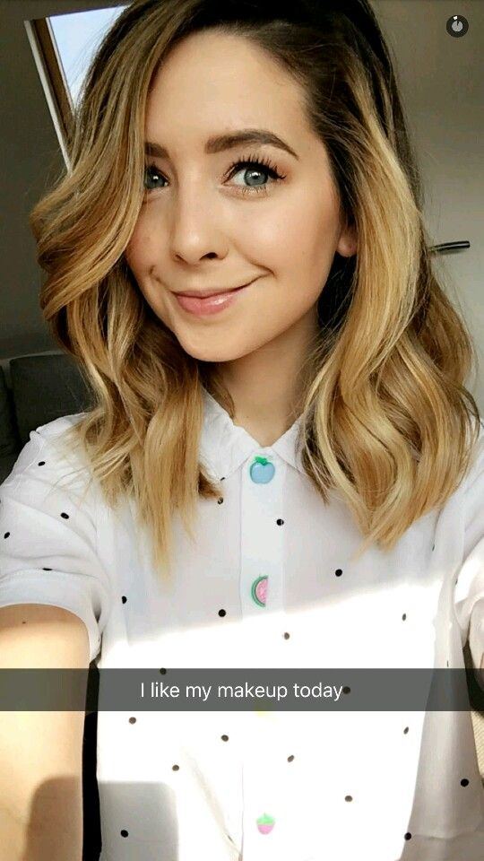 Zoe Sugg - that's a cute blouse! I love the fun pastel buttons on it.