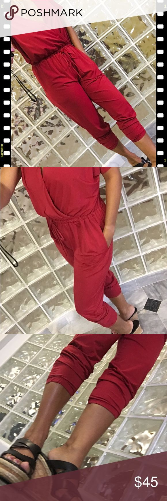 Kardashian Kollection Red Jogger Pant Romper Pants Kardashian Kollection Red Jogger Romper Pants.  Style up your summer wardrobe with this comfortable piece.  Never worn, tags removed.  Marked a medium size but fits more like a small.  Bundle with other items for a discount, or make an offer! Kardashian Kollection Pants Jumpsuits & Rompers
