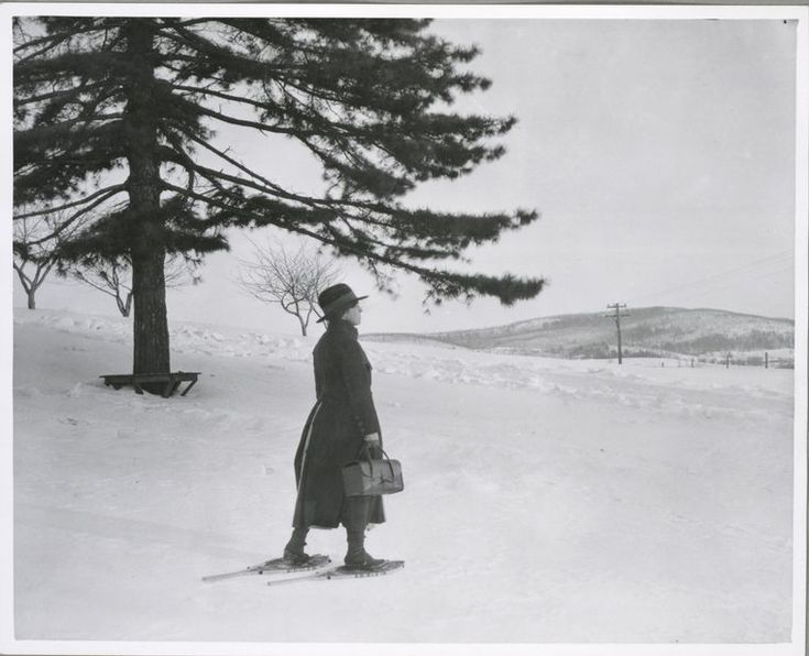 Rural health nurse, upstate New York, on snowshoes. 1900-1937. (Lewis W. Hine)
