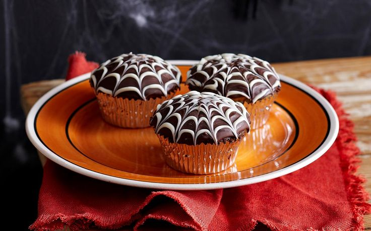 Choc cobweb cupcakes recipe - By Woman's Day, Get into the spirit of Halloween with these delicious choc cobweb cupcakes!