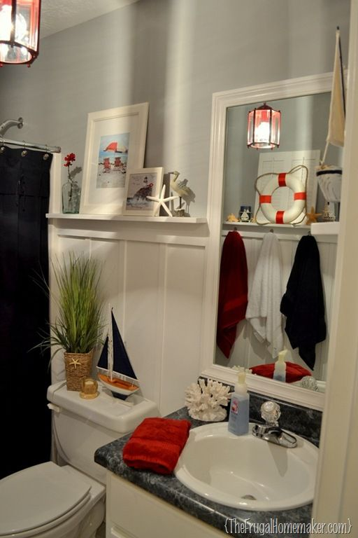 Nautical theme bathroom - love the red and navy colours together!