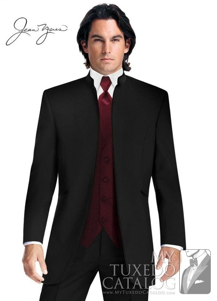 The Black 'Mirage' Mandarin Tuxedo by Jean Yves takes the simple lines of traditional black tie to an even more streamlined style. This fashion tuxedo features an open front with no buttons, no lapel, a satin mandarin collar, and slanted satin besom pockets. The minimalist approach to formal fashion is both contemporary and tasteful, perfect for anyone wanting to make a statement at their next formal event!