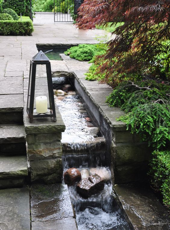 Patio edge water feature / #waterfeature #landscaping #patio. Source: http://threedogsinagarden.blogspot.ca/2012/06/how-other-half-garden.html