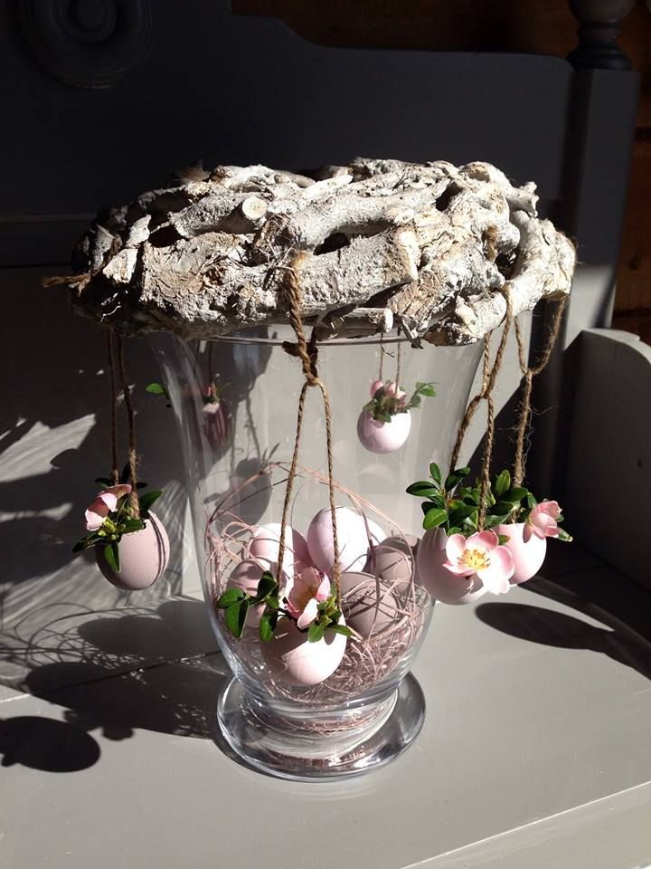 How perfect a #Springdecoration-an #upcycledvase, forest dropped branches, and reused breakfast shells. Like an #Easter merry-go-round  The sweetest thing.  :))  pastel http://www.GoodOldDaysFlorist.com