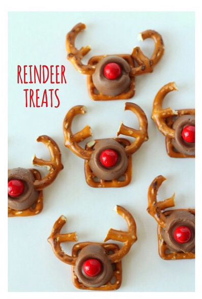 "Reindeer Treats - so cute for a cookie swap!  INGREDIENTS: Square pretzels Regular pretzels Rolos candy Red Sixlets candy (Target)  1) Preheat oven to 230; line baking sheet with parchment paper 2) Place square pretzels on sheet, then place unwrapped Rolos. 3) Cut the regular pretzels with a knife so they look like an ""E"". 4) Place sheet in oven for 2 - 3 minutes.  Remove from oven and insert two antlers at the same time.   5) Place a sixlet for the nose & VOILA! You've made reindeer treats!"