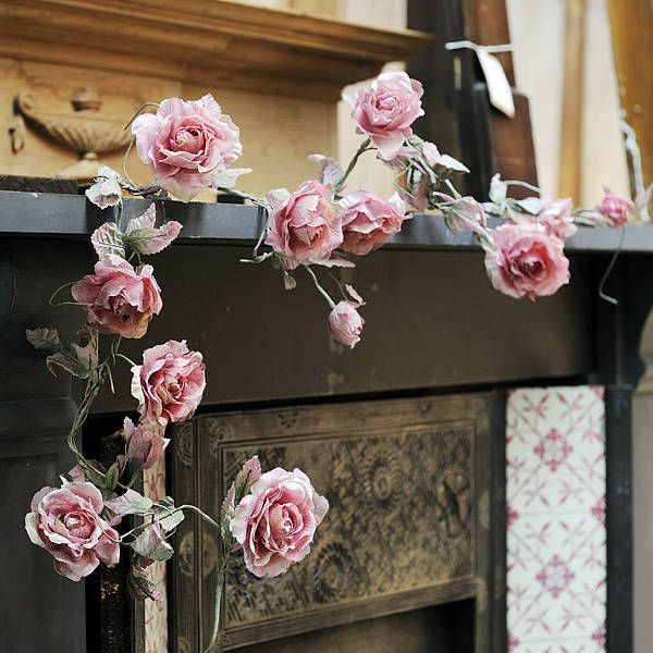 Pretty sure I could make this myself and save a few pennies! A bunch of fake roses, wire and pale green tissue paper.