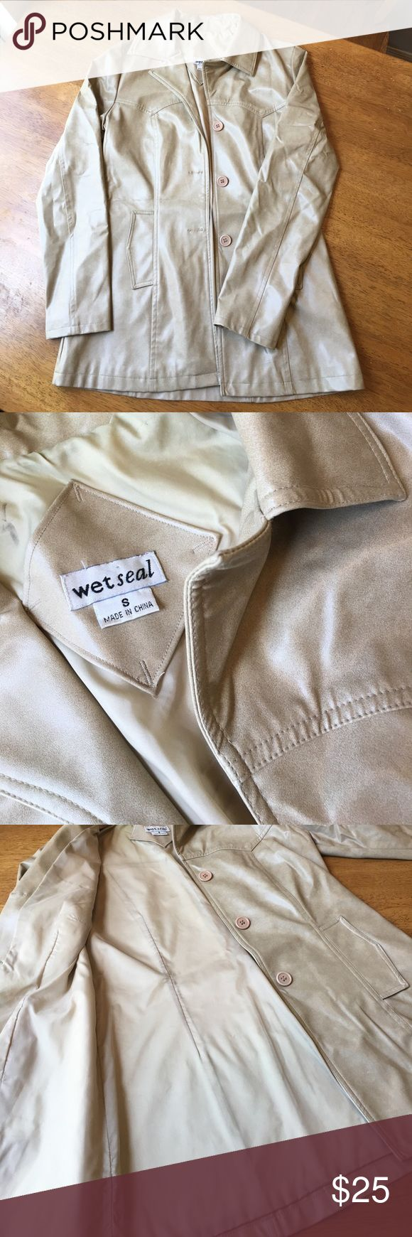 Wet Seal Button Down Rain Coat Wet Seal 100% Polyurethane Beige Button Down Rain Coat. Excellent Condition other than the small defects shown in the last picture. These small defects are very inconspicuous. They are located on the back collar region. Wet Seal Jackets & Coats Trench Coats