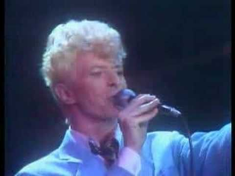 """David Bowie - Let's Dance {And if you say, """"Run.""""--I'll run with you. And if you say, """"Hide.""""--we'll hide. Because my love for you would break my heart in two. If you should fall into my arms and tremble like a flower.}"""