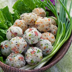 Korean rice balls made with leftover short grain rice, carrots, mushrooms, bacon, and green onion