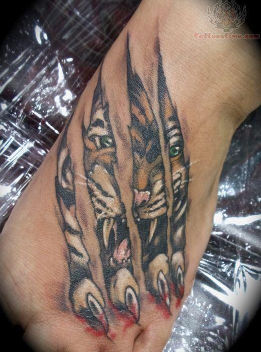Torn Ripped Skin Paw Tattoo